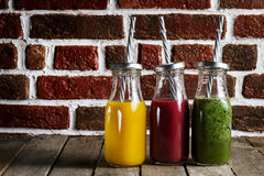 Tasty colorful fresh homemade smoothies in glass jars on wooden Stock Photo