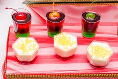 Tasty colorful jelly with cherries in glass dishes_. Tasty colorful jelly with cherries in glass dishes stock photos