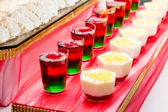 Tasty colorful jelly with cherries in glass dishes_. Tasty colorful jelly with cherries in glass dishes royalty free stock photo