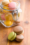 Tasty colorful macarons in jar Royalty Free Stock Image