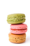 Tasty colorful macaroon bite on white background Stock Images