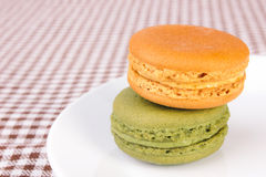 Tasty colorful macaroon on a plate Stock Photography