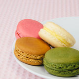 Tasty colorful macaroon on a plate Stock Photo