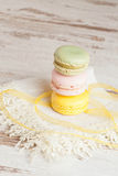 Tasty colorful macaroon. Vertical, close up Stock Photo