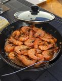 Fried shrimps in a frying pan outdoors. stock photo