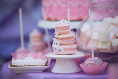 Tasty confectionery on the table. Macaroons. Marshmallows. Cupcakes. Cacke. Royalty Free Stock Image