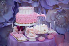 Tasty confectionery on the table. Macaroons. Marshmallows. Cupcakes. Cake. Tasty confectionery on the table Royalty Free Stock Image