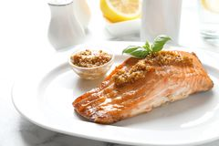 Tasty cooked salmon with mustard on plate. Closeup Stock Photography