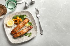 Tasty cooked salmon served for dinner. Top view Royalty Free Stock Images