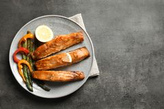 Tasty cooked salmon served for dinner. Top view Stock Images