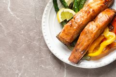Tasty cooked salmon with vegetables. On plate Stock Photo