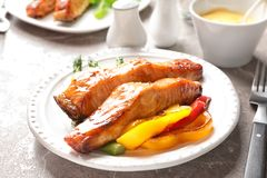 Tasty cooked salmon with vegetables. On plate Stock Photography