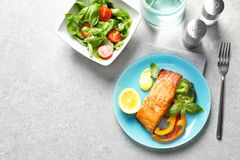 Tasty cooked salmon with vegetables served. For dinner, top view Stock Photo