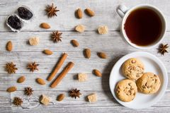 Tasty cookies with black tea, nuts, almonds, anise stars, brown stock photos