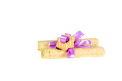 Tasty cookies knotted purple ribbon - a treat for a loved one. Royalty Free Stock Photography