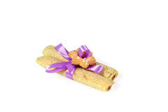 Tasty cookies knotted purple ribbon - a treat for a loved one. Royalty Free Stock Photos