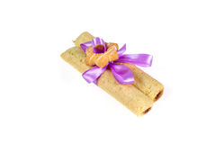 Tasty cookies knotted purple ribbon - a treat for a loved one. Royalty Free Stock Photo