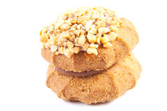 Tasty cookies with nuts. One sweet tasty cookies on a white background Stock Images