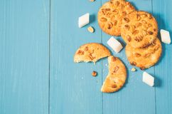 Tasty cookies with nuts and lump sugar on a blue wooden background/tasty cookies with nuts and lump sugar on a blue wooden. Background, top view and copy space stock photography