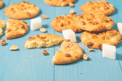 Tasty cookies with nuts and lump sugar on a blue wooden table/tasty cookies with nuts and lump sugar on a blue wooden table,. Selective focus stock images
