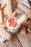 Tasty cookies Savoiardi and whipped cream  with strawberries. ve Royalty Free Stock Photo