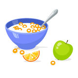 Tasty cornflakes in blue bowl with spoon and green apple and orange. Stock Photo