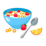 Tasty cornflakes in blue bowl with spoon and strawberry and orange. Royalty Free Stock Photography