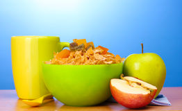 Tasty cornflakes in green bowl, apples Stock Photography