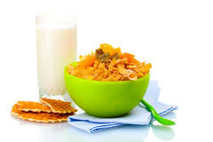 Tasty cornflakes in green bowl and glass of milk Royalty Free Stock Photos