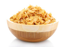 Tasty cornflakes in wooden bowl Stock Image