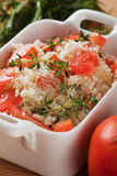 Tasty couscous with herbs ant fresh tomato Stock Photography