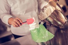 Close up of cream being put in the bag royalty free stock images