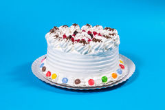 Tasty creamy birthday cake colorful candy adorned Stock Images