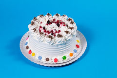 Tasty creamy birthday cake colorful candy adorned Royalty Free Stock Photography