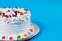 Tasty creamy birthday cake colorful candy adorned Royalty Free Stock Images