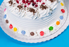 Tasty creamy birthday cake colorful candy adorned Stock Photography