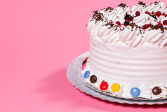 Tasty creamy birthday cake colorful candy adorned Royalty Free Stock Image