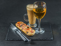 Tasty crispy bread with melted cheese, pepperoni, ham, mushrooms Royalty Free Stock Photos