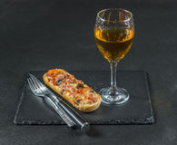 Tasty crispy bread with melted cheese, pepperoni, ham, mushrooms Stock Photography