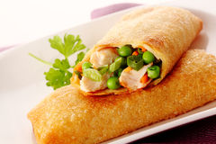 Tasty crispy spring roll with crab and peas Stock Image