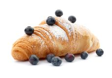 Tasty croissant with berries and sugar powder Stock Image