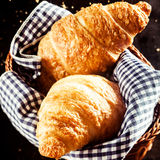 Tasty Croissant Bread on Basket with Cloth Royalty Free Stock Photos