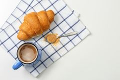 Tasty croissant and cup of coffee on light background,. Top view Royalty Free Stock Images