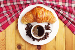 Tasty croissant and cup of coffee Royalty Free Stock Images