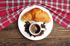 Tasty croissant and cup of coffee Stock Image