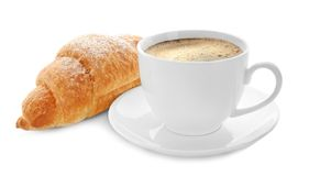 Tasty croissant and cup of coffee. On white background Stock Photos