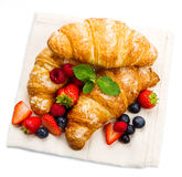 tasty croissants with berries on white background Royalty Free Stock Images