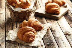 Tasty croissants. On brown wooden background Stock Image