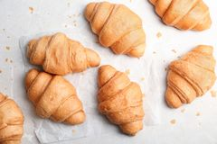 Tasty croissants on light background. Top view Stock Image
