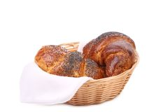 Tasty croissants with poppy on wicker basket. Royalty Free Stock Photography